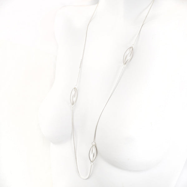 Streamline Lattis Shapes form a Minimal Siloutte on this Long Necklace in Sterling Silver