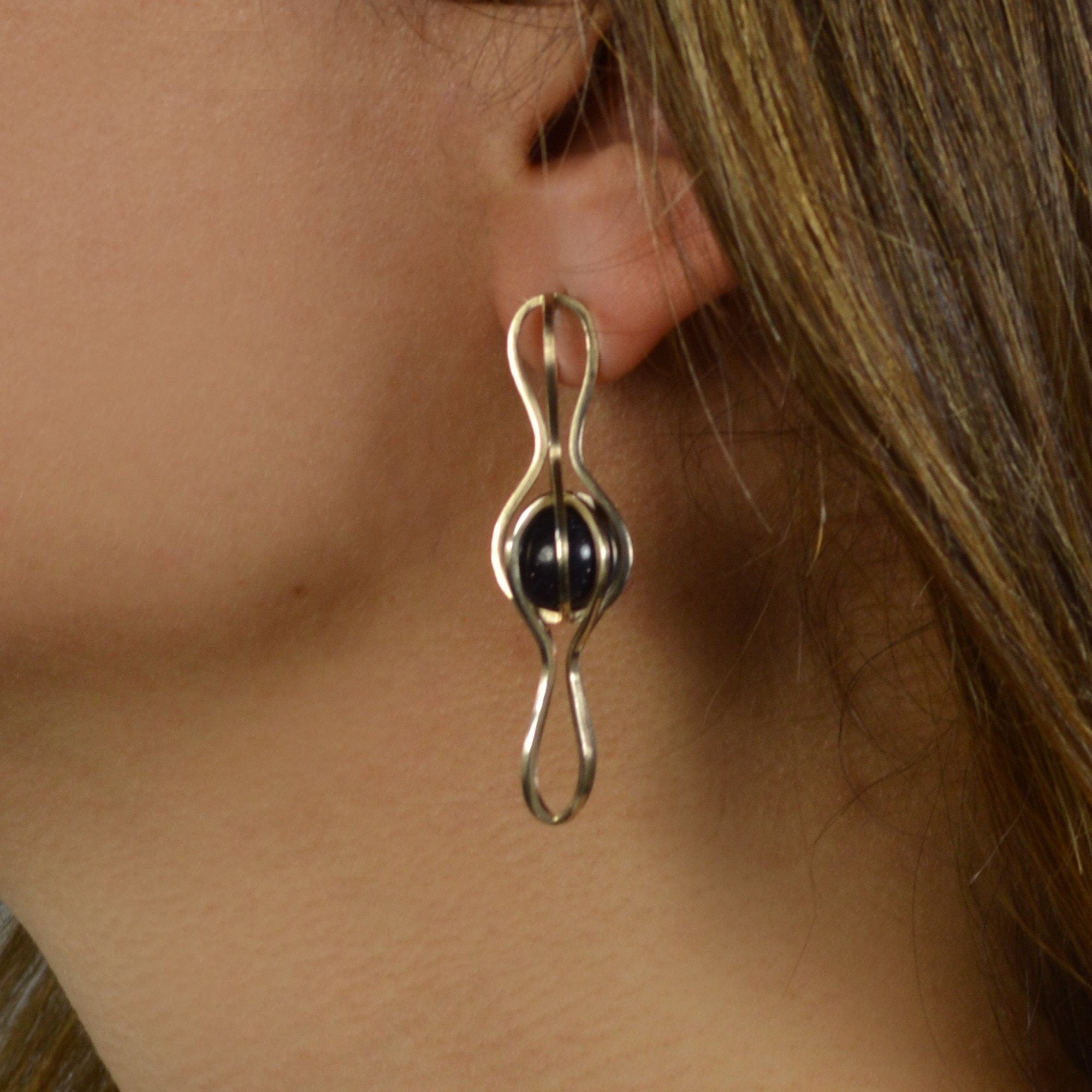 Infinite Orbit Earrings Capture the Starry Night