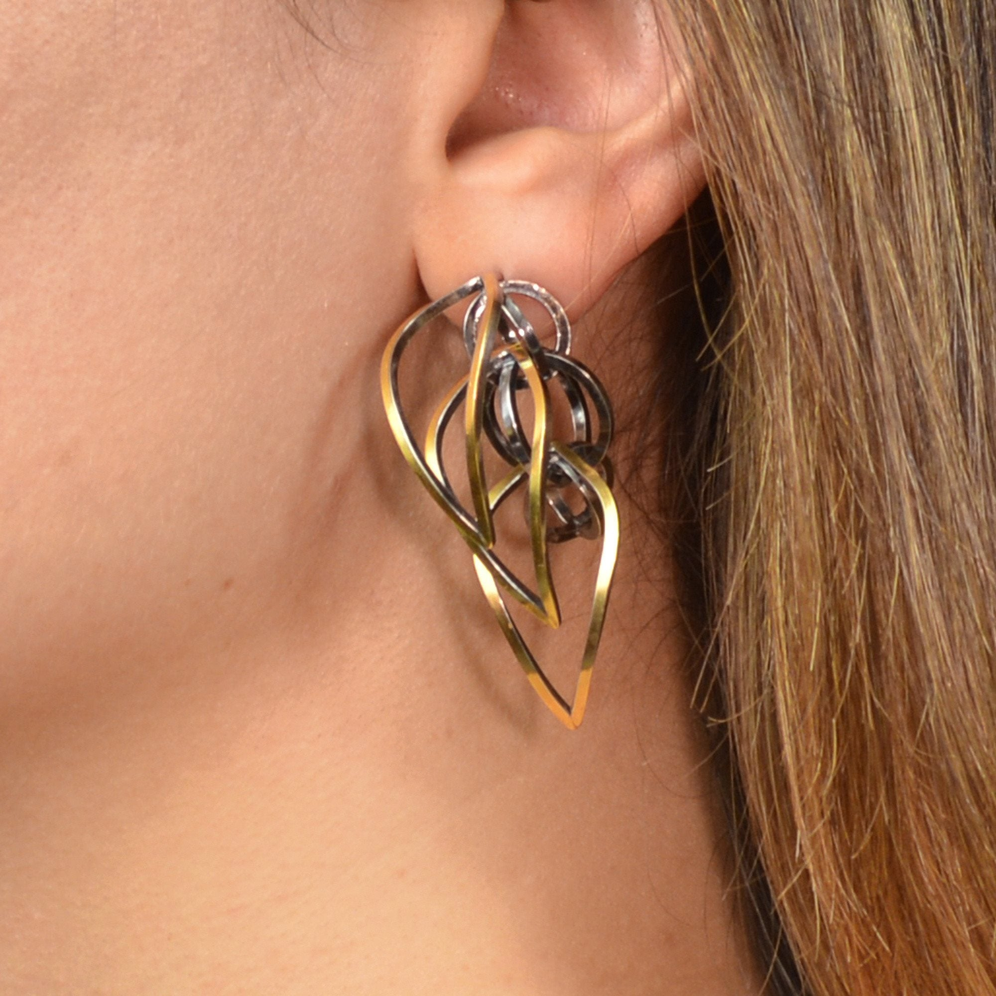 Tighra Earrings in 22k gold and Sterling Silver