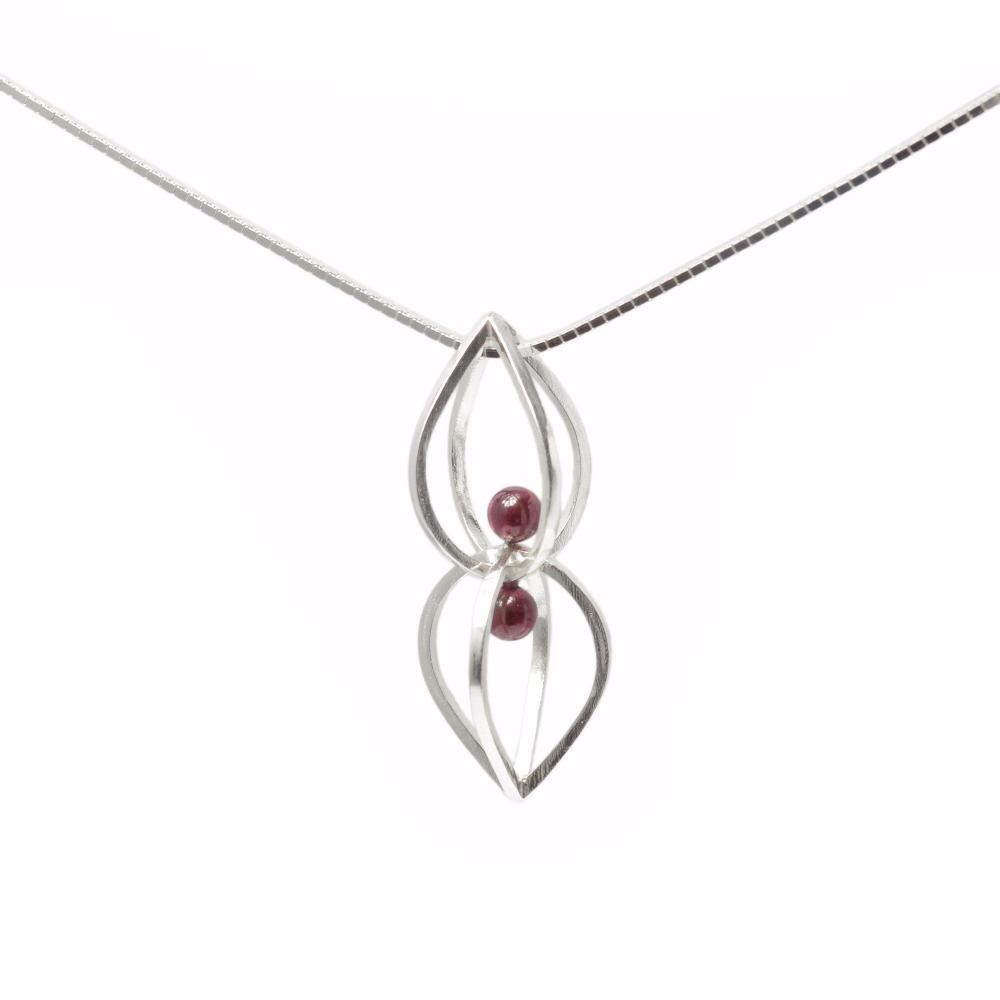 Seed Pendant with Garnet on 18inch Sterling Silver Chain