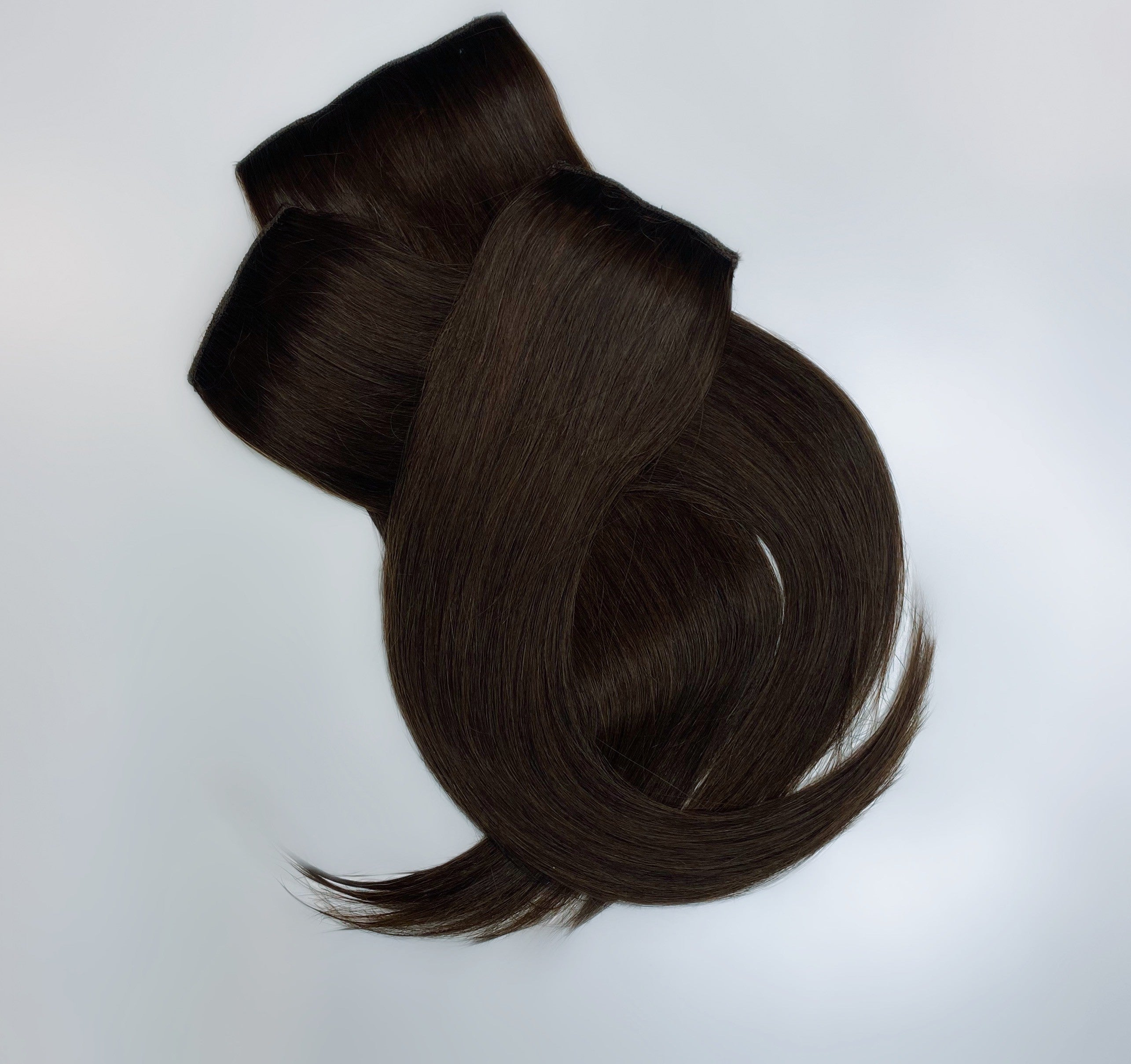 "This three piece hair enhancement is perfect for those who don't necessarily need a hair topper but are looking for pieces to add in the right places to add volume seamlessly.  This trio are each 12"" in length and all together weigh 120g!"