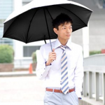 Men use special umbrellas to protect from UVA rays