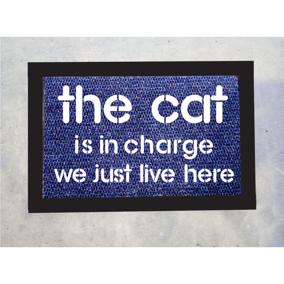 The Cat Is In Charge Door Mat