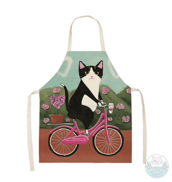 Cute cat kitten apron linen kitchen home accessories gift for cat lovers tuxedo black and white cat cycling pink picycle rose bushes