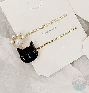 Here is a super cute cat hairpins set of 2, with a cat and pearl paw design