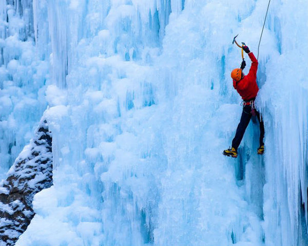Ice climbing on a wall of frozen ice