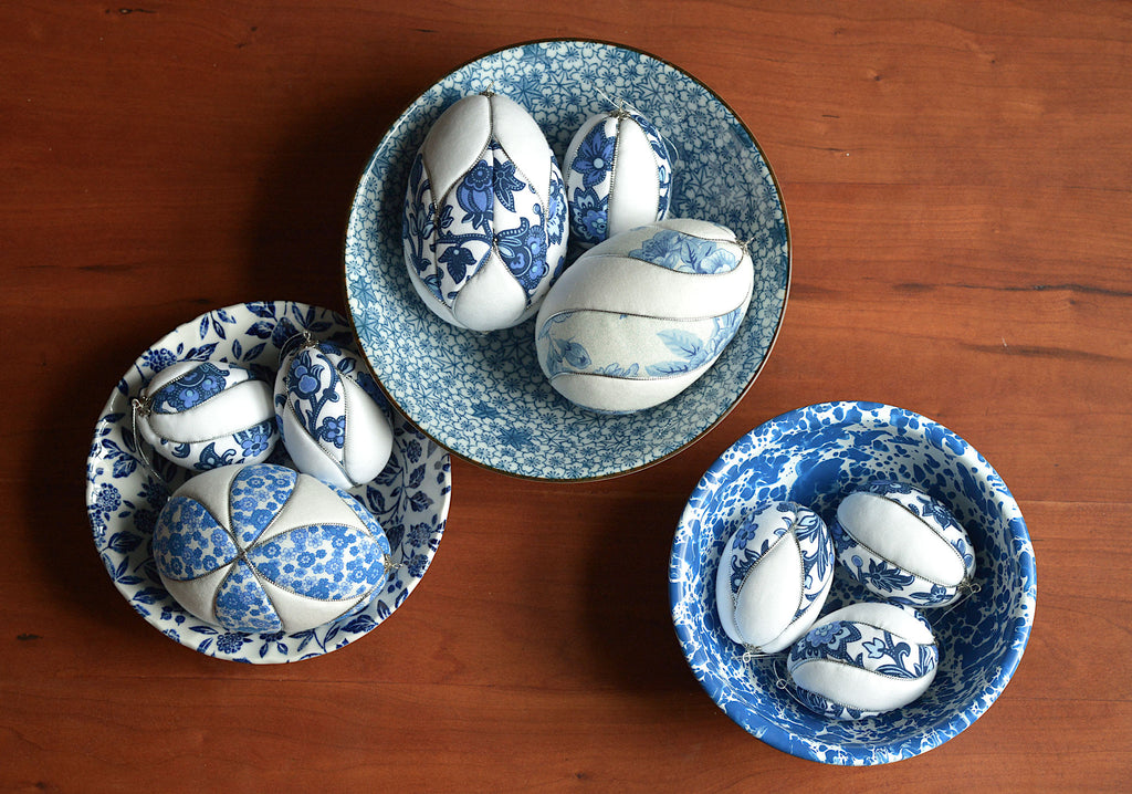 blue and white fabric Easter eggs in blue and white bowls
