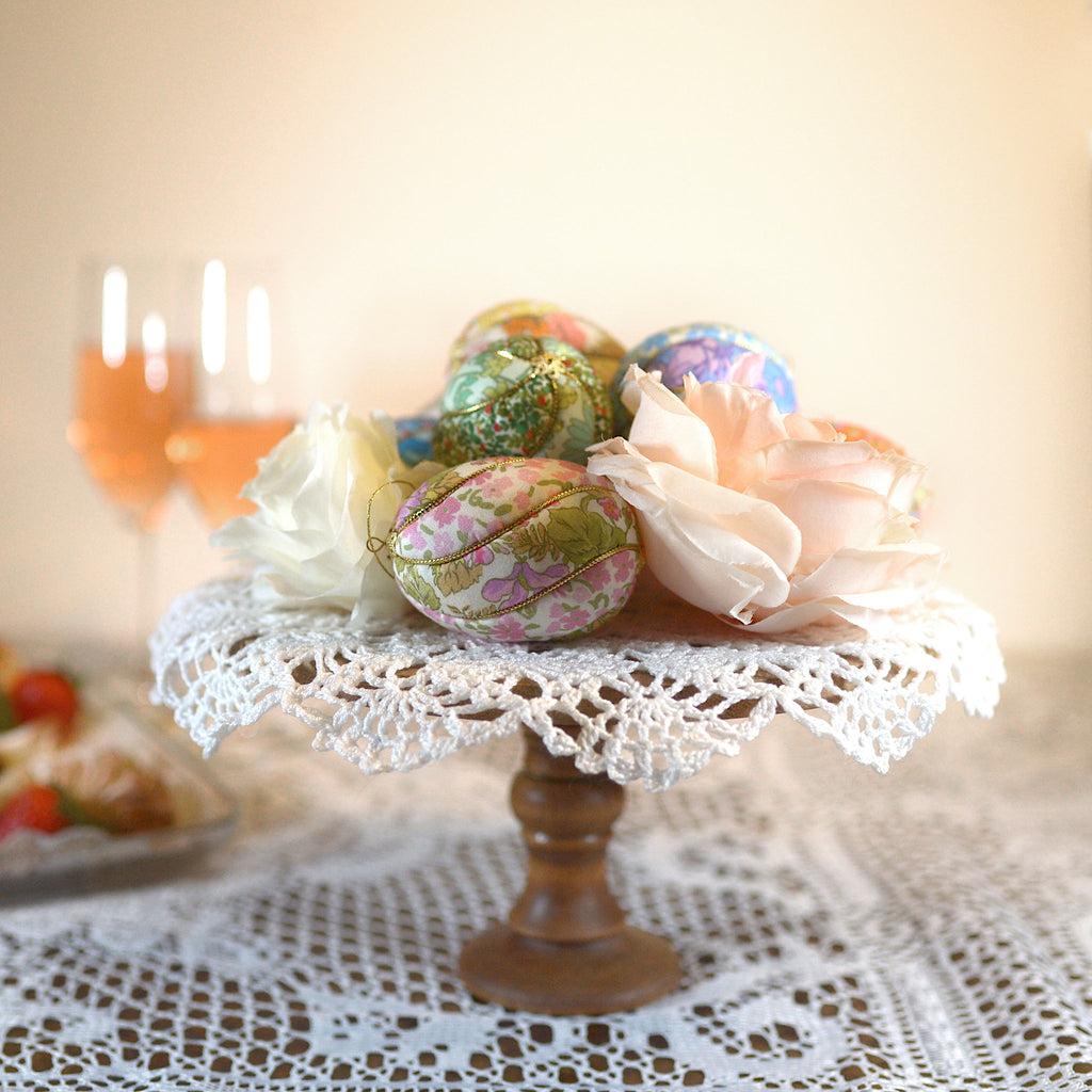 colorful Easter egg ornaments with peonies on cake stand