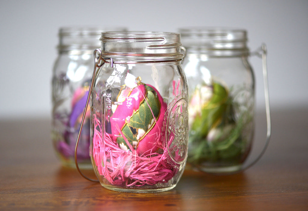 colorful Easter egg ornaments in Mason jars