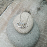 Sterling Silver 4 Hammered Rings Necklace