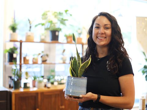 Veronica Leon owner of Verde Tribe Plant Shop holding plant