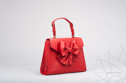 PEONY Leather Top Handle Handbag with Bow in Red $25