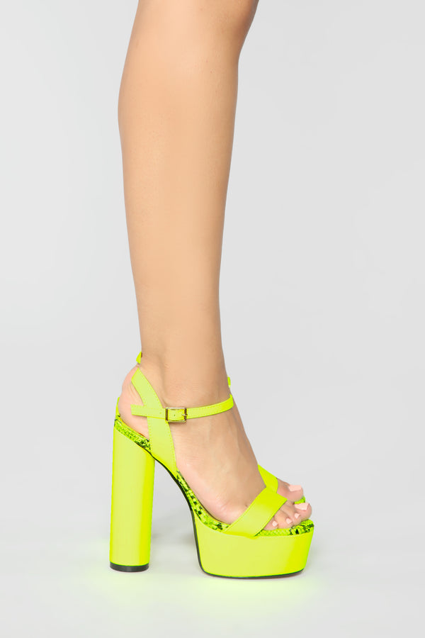 bce8a538420 Those Are Killer Heeled Sandals - Neon Yellow