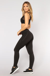Get A Move On Lace Up Performance Leggings - Black Angle 3