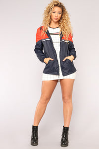 Breaking Wind Windbreaker - Navy Orange