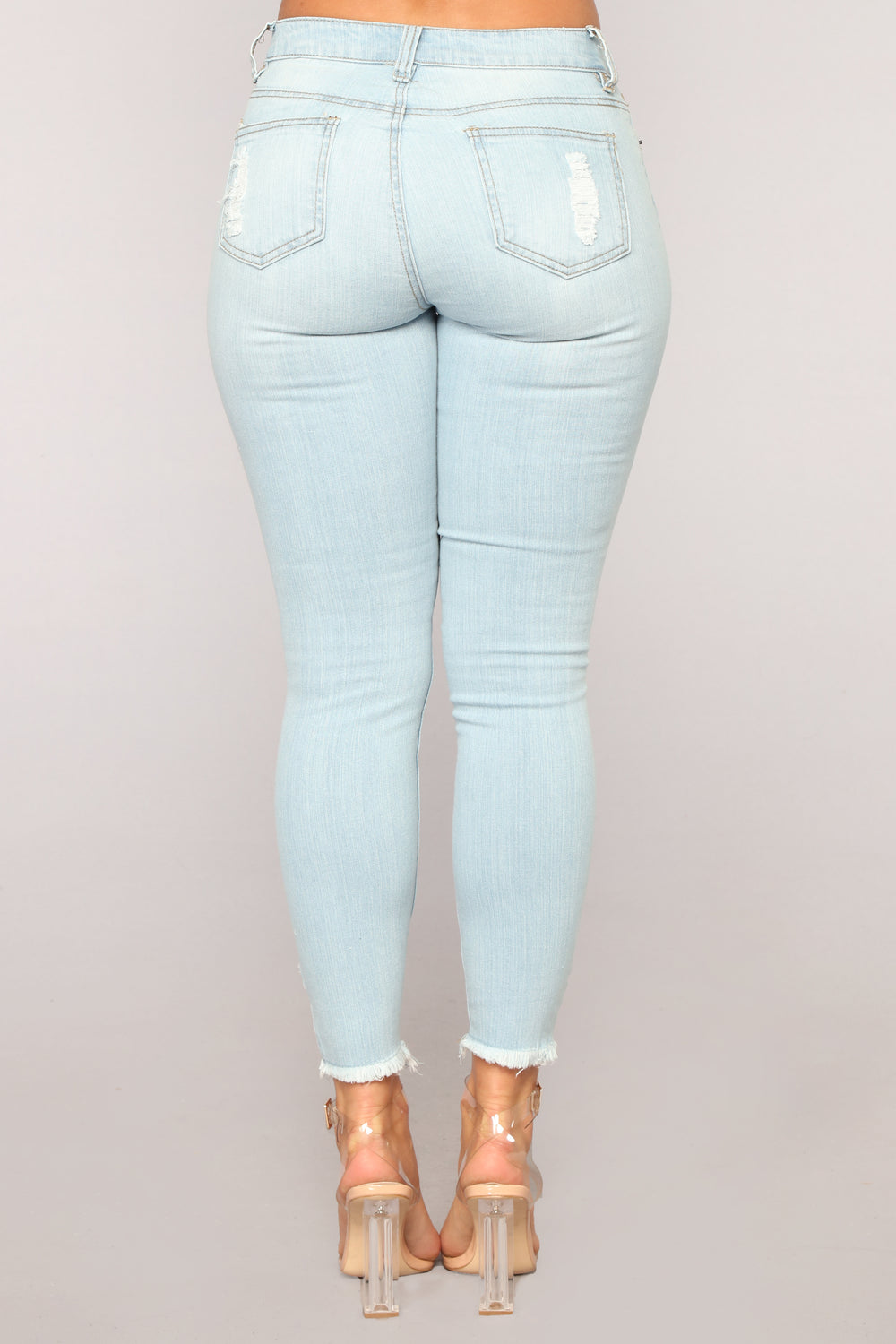 Genesis High Rise Distressed Jeans - Light Blue Wash