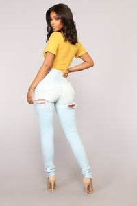 Cut The BS High Rise Distressed Jeans - Light Wash