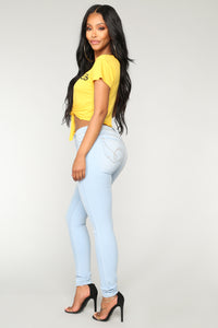 The Good Life Mid Rise Skinny Jeans - Light Blue Wash