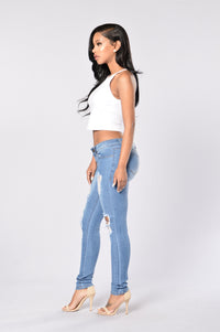 Worn and Torn Jeans - Medium Blue