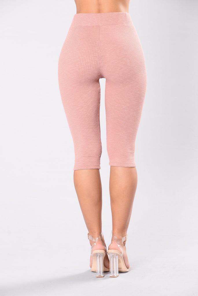 workout leggings in pink mauve color
