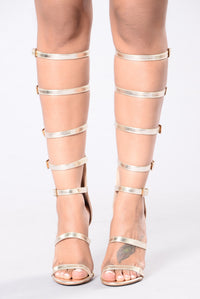 Cute gladiator club heels in gold for going out