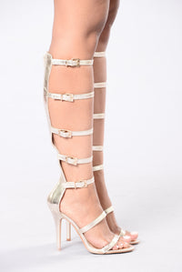 High strap heels in gold for women casual or going out