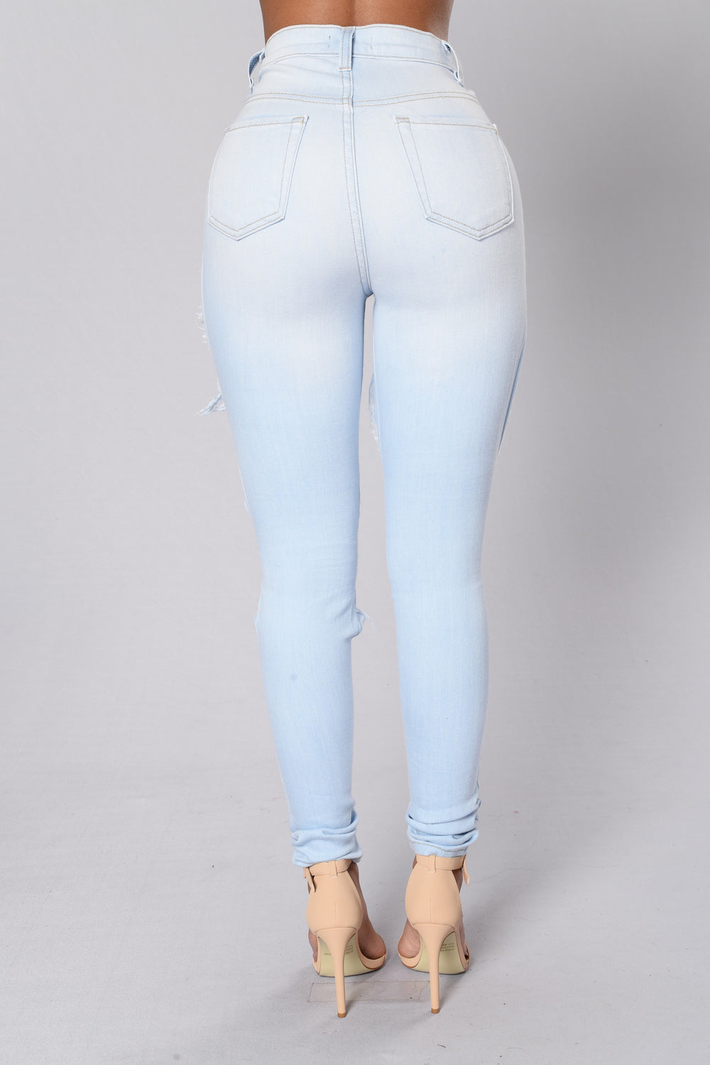 The new craze in jeans is light colored or stone washed jeans that can cost a fortune, but, if you know how to lighten the color of dark jeans, you can make these fashion forward pants yourself.