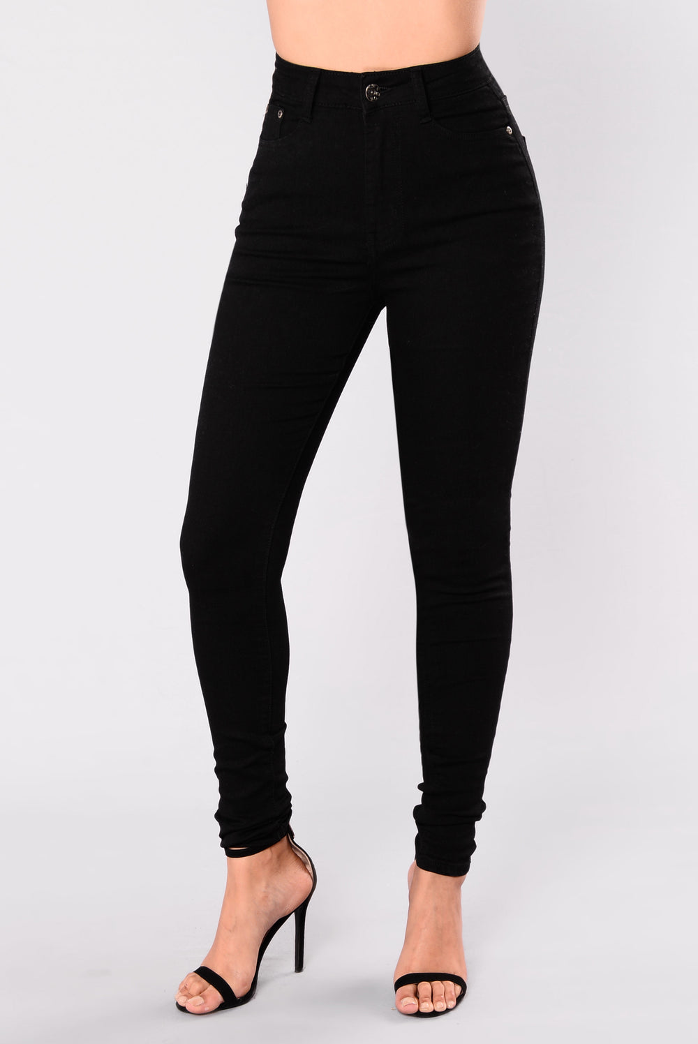 Slipping into the Practice Makes Perfect Black High-Waisted Skinny Jeans is one of those things that just comes naturally! Super stretchy denim shapes a high-waisted fit with top button (and hidden zip fly), two back patch pockets, and skinny pant legs with rips at the knees/5().