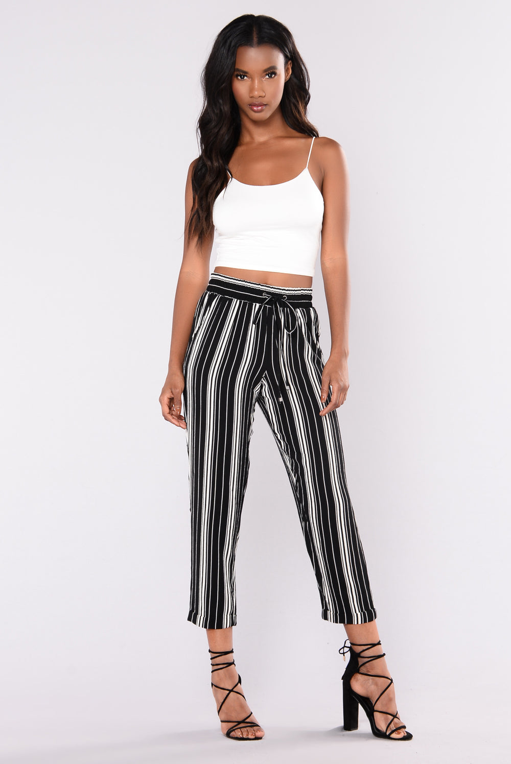Striped pants are ubiquitous wardrobe pieces that fashion mavens seem to love incorporating into their ensembles. If you like the look of rocker chic, pair your striped pants with a .