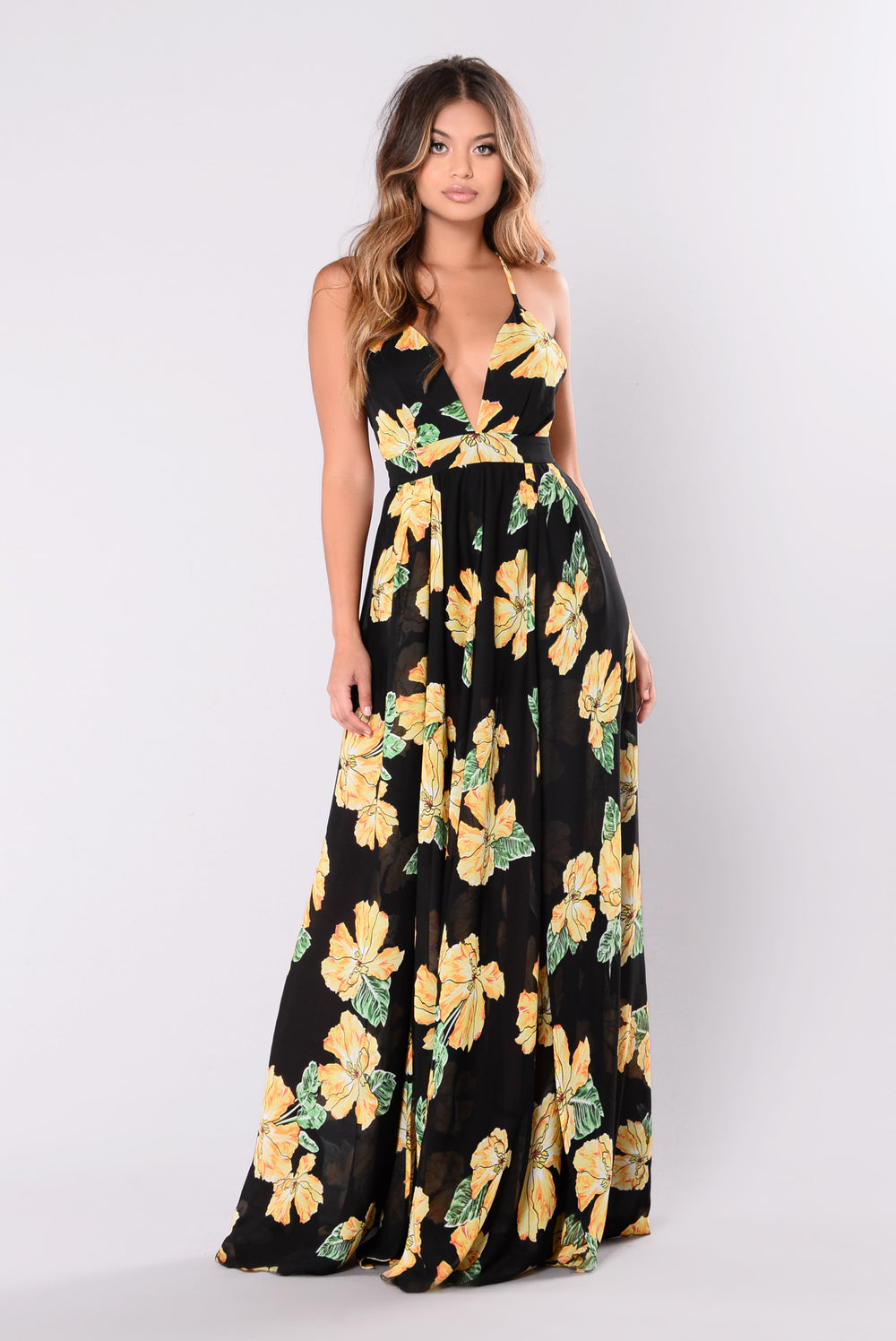 The maxi skirt features a high side asymmetrical slit to show off your glowing gams! The all over floral pattern is complemented with a dark background. Dress is composed of lightweight woven fabric that offers a relaxed fit with minimal stretch.