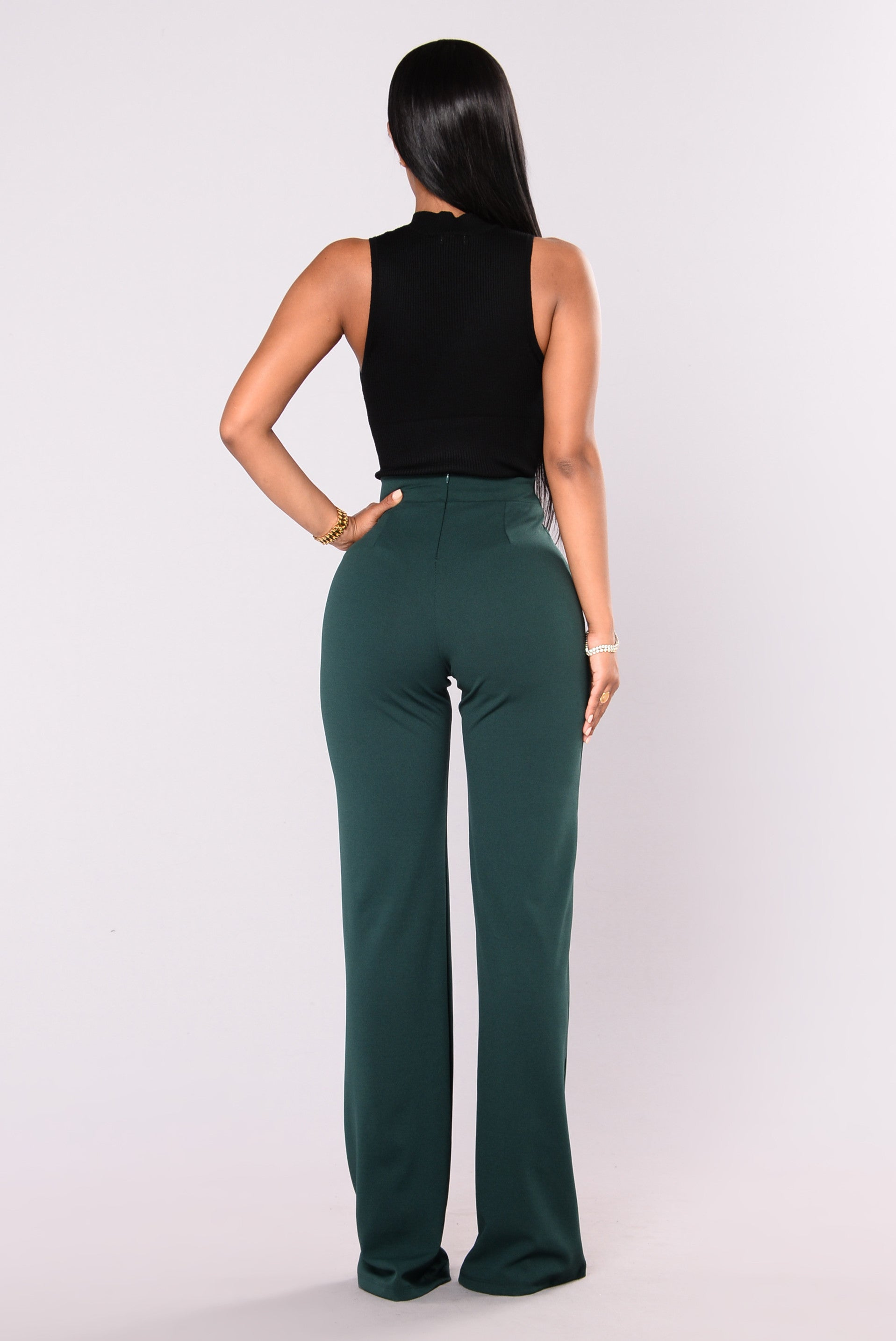 High waisted pants and dress pants for women are the perfect work pants and come in essential colors like black, white and red. For a dramatic look, grab a pair of palazzo pants, wide leg pants or slit pants in a solid or print.