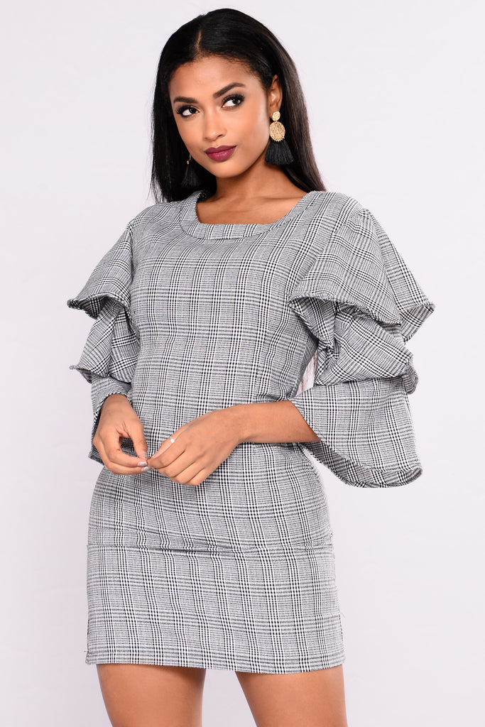 Black and blue houndstooth lined dress with leather trims and zip shoulders and pockets, hidden zip closure on back and slit on side-back (still closed). Bust 40