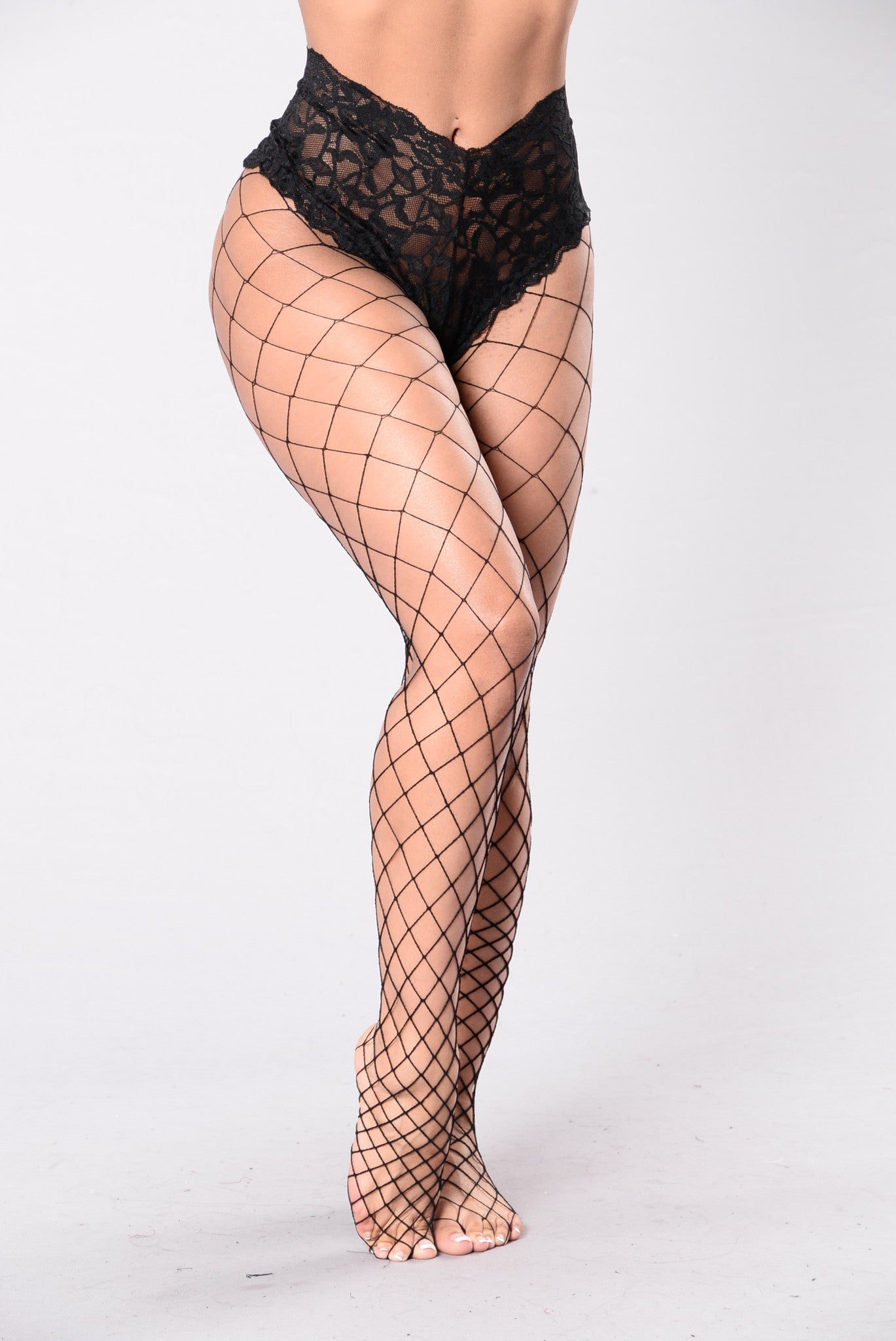 Women wearing fishnet pantyhose