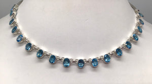 Sterling silver multi link Blue Topaz necklace.