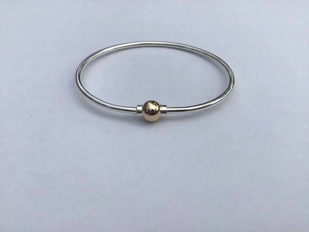 Cape Cod bracelet, sterling silver and solid 14 kt. Bead clasp.
