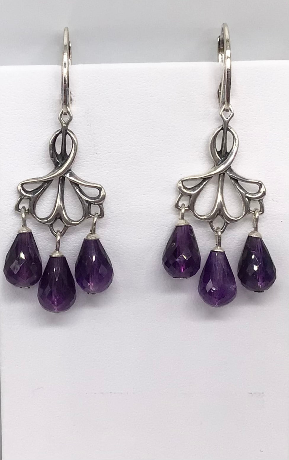 Sterling silver Amethyst chandelier style earrings.