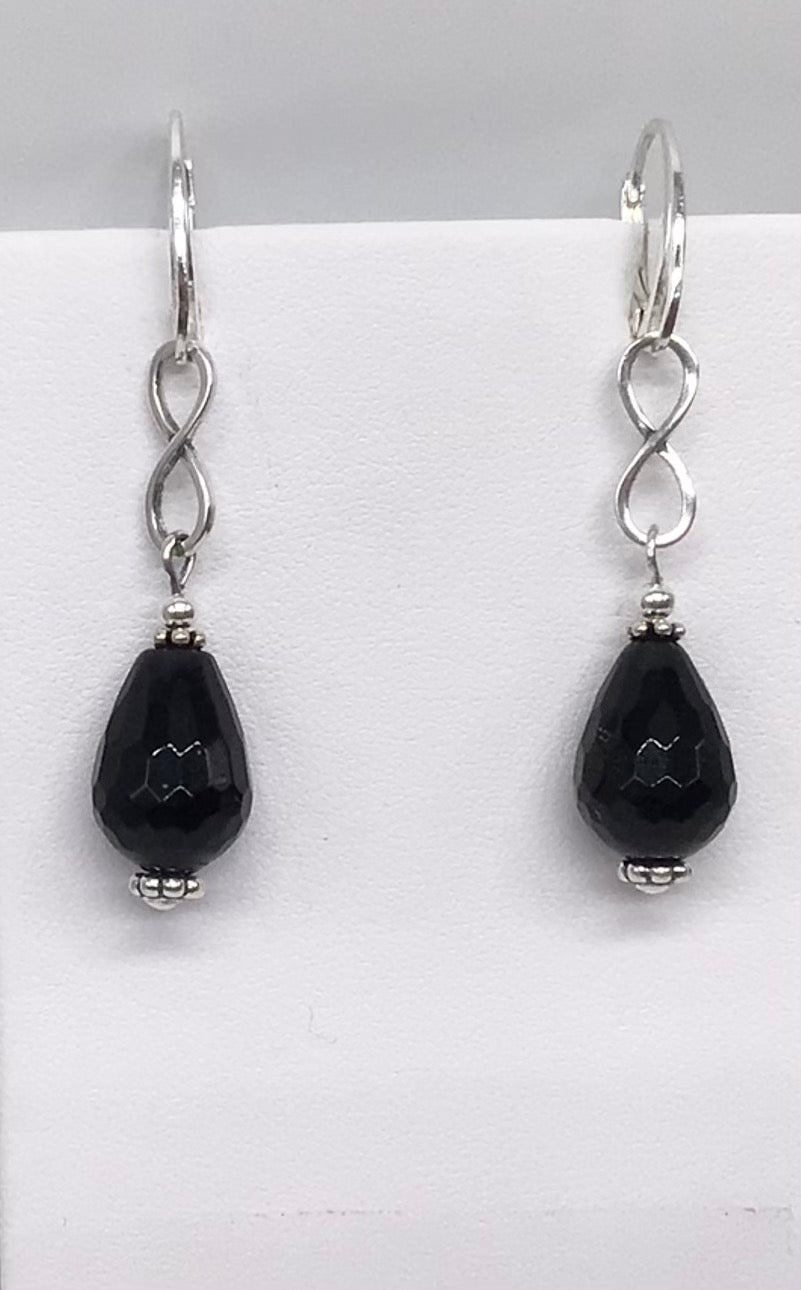 Sterling silver and Faceted Onyx earrings.
