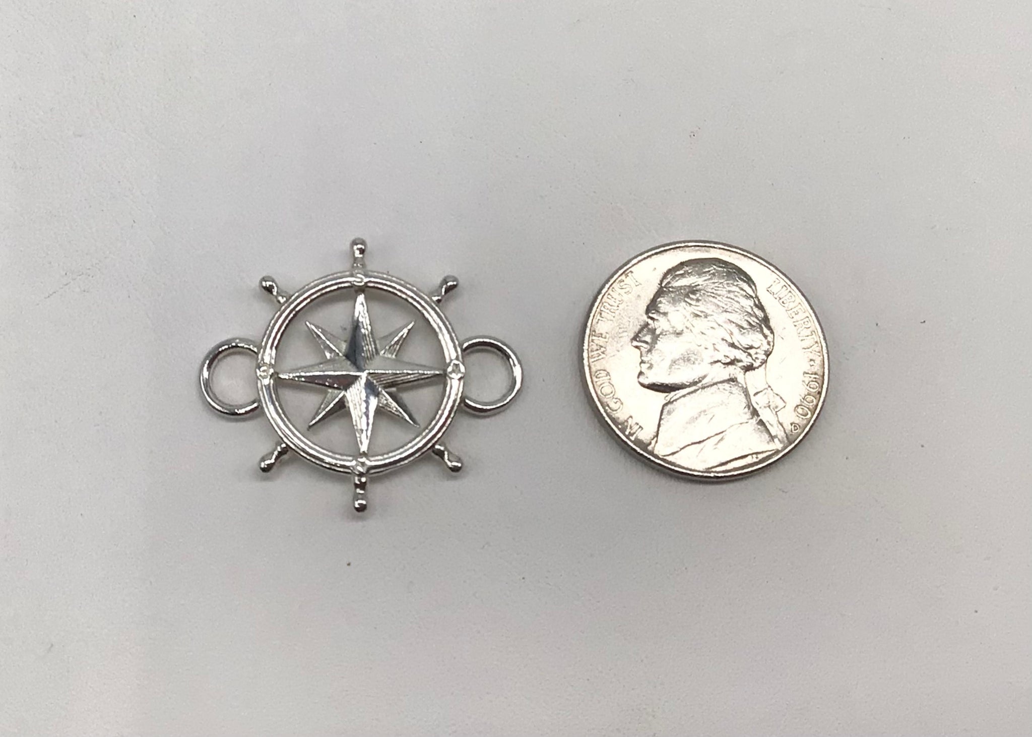 Sterling silver Compass Rose inside a ship's wheel interchangeable topper.