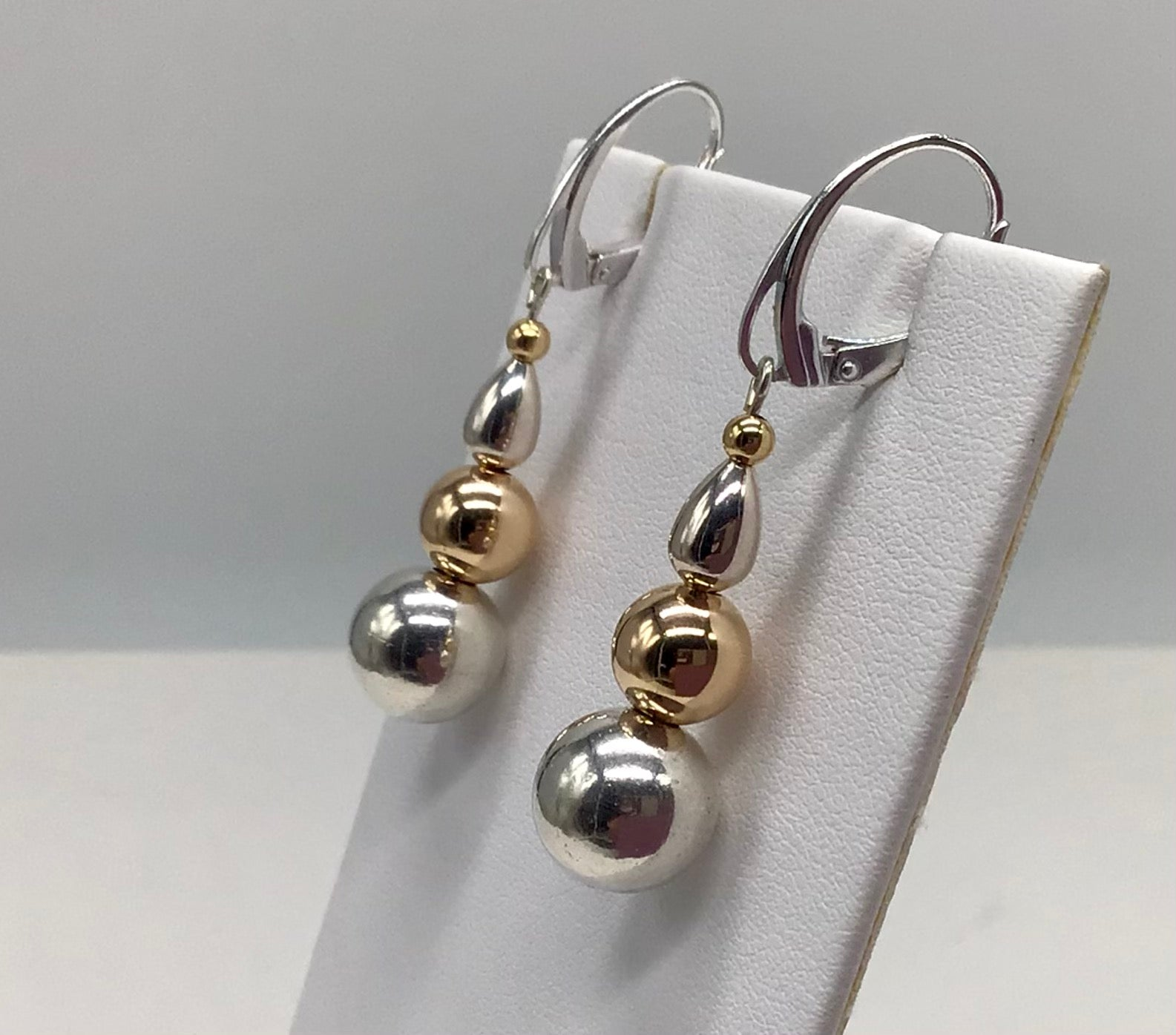 Dangling Sterling silver and 14 kt. Gold Cape Cod earrings