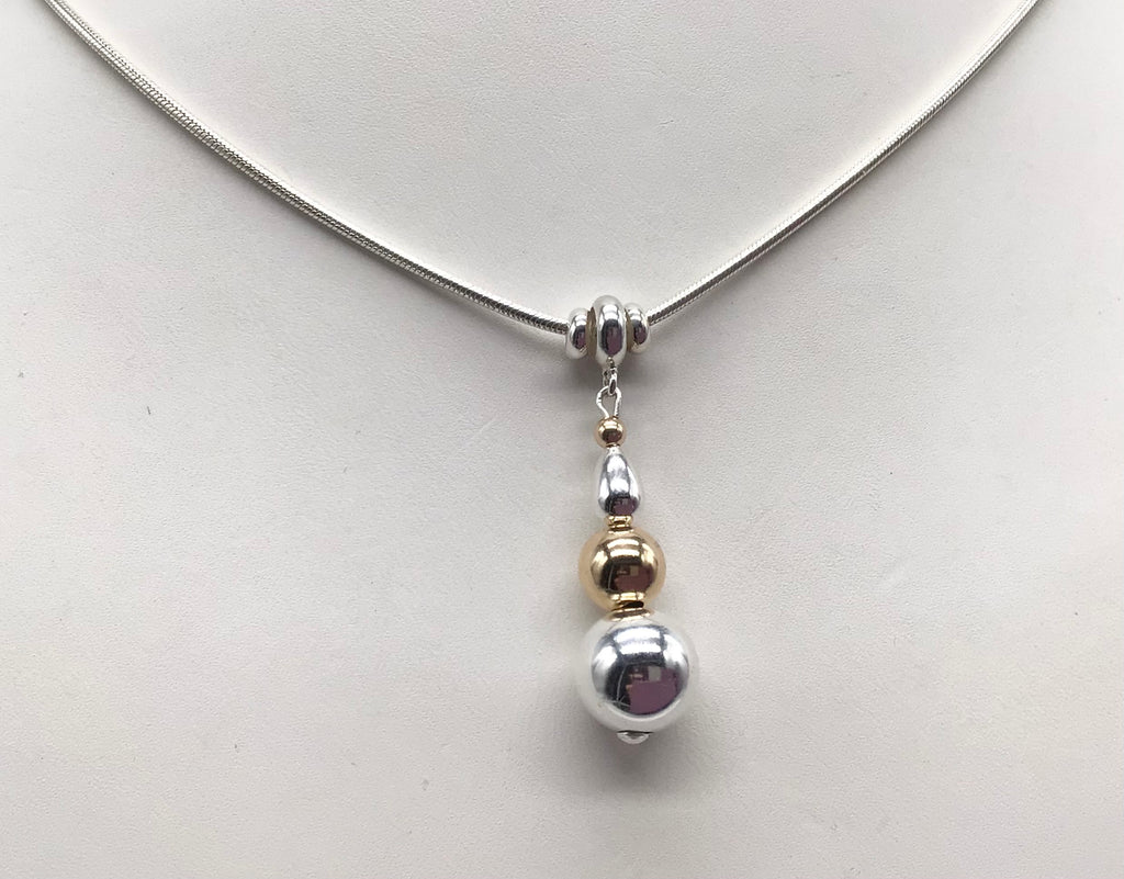 Sterling silver and 14 kt. Gold beads Cape Cod necklace.