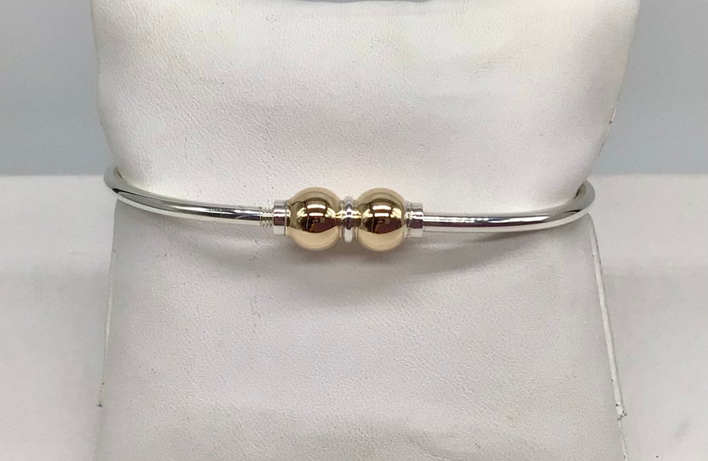 Sterling silver with two 14 kt. beads Cape Cod bracelet