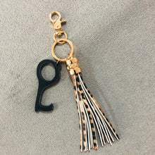 Load image into Gallery viewer, Tassel Keychain with Hands Free Device in Black or Ivory
