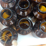 Amber glass capsule bottles w lid