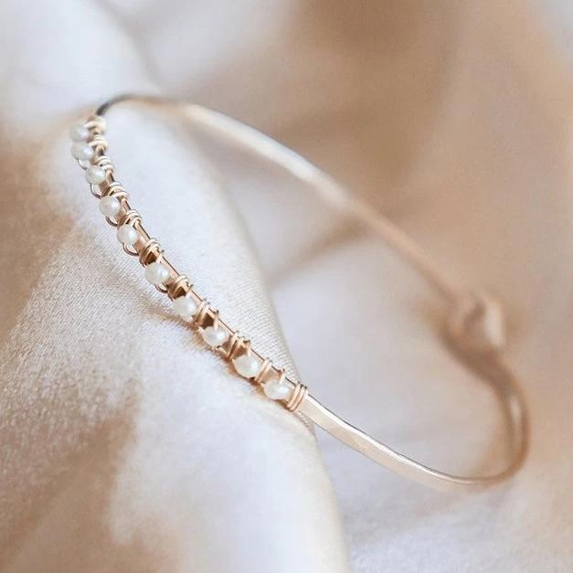 gold filled, freshwater pearl bangle bracelet on a white background