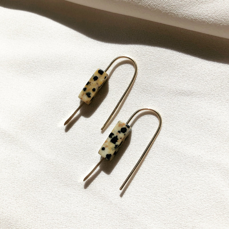 handmade earrings made with gold and sterling silver and Dalmatian jasper stone