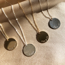 sterling silver and gold filled, handstamped custom discs necklaces with different Valentines Day sayings on them