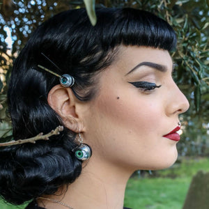Model with vintage pin up style ears doll eye hair grip and earrings