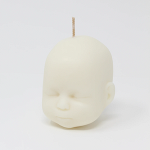 Doll head shaped candle in white
