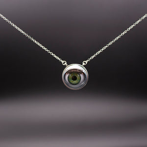 green eye necklace shown on black plain background