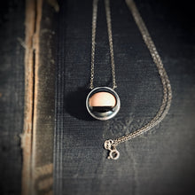 Load image into Gallery viewer, Image showing the necklace laying down, meaning the eye is closed.